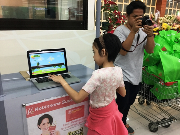 My daughter eagerly tried BiscuitRun in Robinsons Supermarket Pioneer