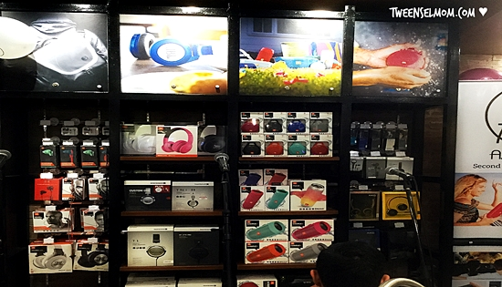 A. Refinery display of assorted brands of speakers, headphones and music accessories