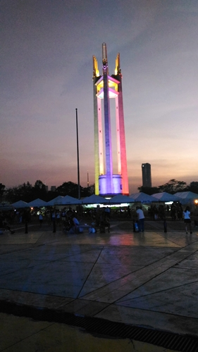 QC Memorial Circle Tower at night