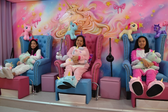 Wearing a onesie while having your nails cleaned and polished was a unique and fun experience. The outfit was soft and comfy.