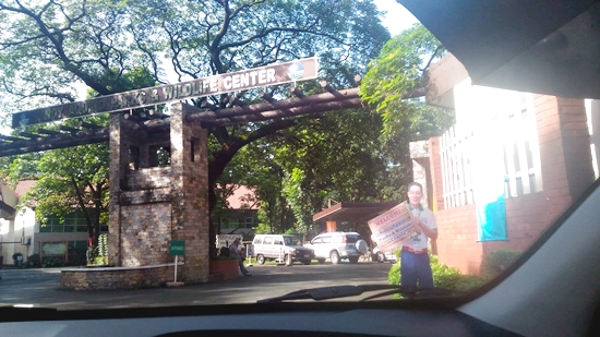 Back entrance of Ninoy Aquino Parks and Wildlife where the parking area is located.